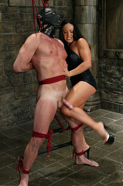 Mistress cherokee slaps and knees her slave into submission