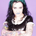Gorgeous green haired goth strips off her latex