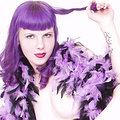 Purple hair girl in striped stockings feather boa