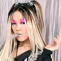 Glammed up asian punk girl smokes naked