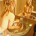 Nude jewelled blonde spreads shaved puss in bath