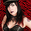 Hot tattooed Gothic dominatrix