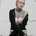 Hot tattooed punk babe by gravestone
