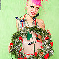 Tattooed pierced and shaved punk Christmas babe