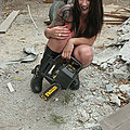 dangerous busty tattoo beauty with chainsaw