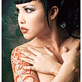 busty tattooed naked Eurasian girl wearing horns