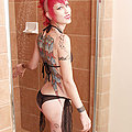 exotic tattooed and pierced beauty in the shower