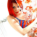 showering redhead plays innocent in striped bikini