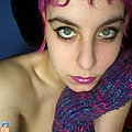 purple haired chick in black fishnet gets naked