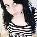 tattooed brunette in leopard print and stripes