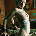 Tattoo punk gets stripped and chained up in game room