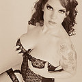 Classic Goth fetish Delilah shows off her corset
