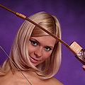 Blonde archer teen posing naked with the bow