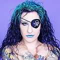 Gothic tattooed pirate girl smirks sexy