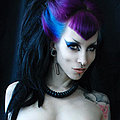 Razor Candi Gothic pin-up super-star in torn fishnets and purple hair