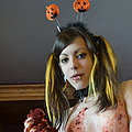 Cute teen Halloween caking mess