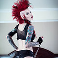 Tattooed Punk babe with mohawk shows off her great ass