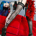 Penny Poison Tempting Tattooed Seductress Teasing in Heels and Stockings