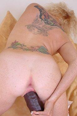 Blonde gets on top of a big brutal dildo