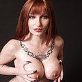 Busty auburn beauty shows piercings tats pussy