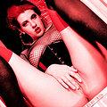 Goth slut in see through panties fishnet corset