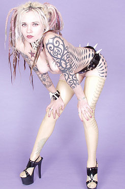 Tattooed punk blonde in high heels and spikes