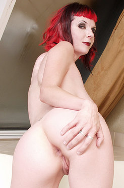 Redhaired punk chick naked and spread in bathtub