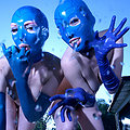 two shaved girls hooded in latex
