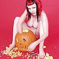 Busty redhead goth eats jack o lantern