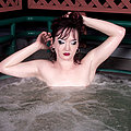 naked goth hottie spreads wide in a hot tub