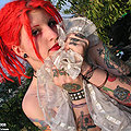inked metal redhead strips down outdoors
