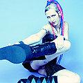 Tattooed Goth-punk girl in schoolgirl skirt
