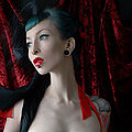 Gothic vampire deathrock babe Razor Candi in hot red ribbons and black lace