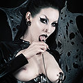 Goth fetish babe in latex with nipple-clamps